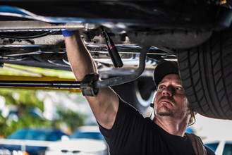 Rich performing a suspension repair