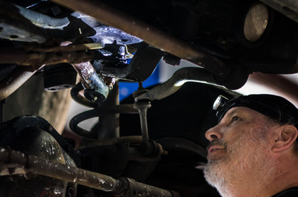 Tom performing a suspension inspection
