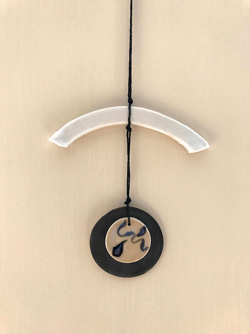 New moon wall necklace