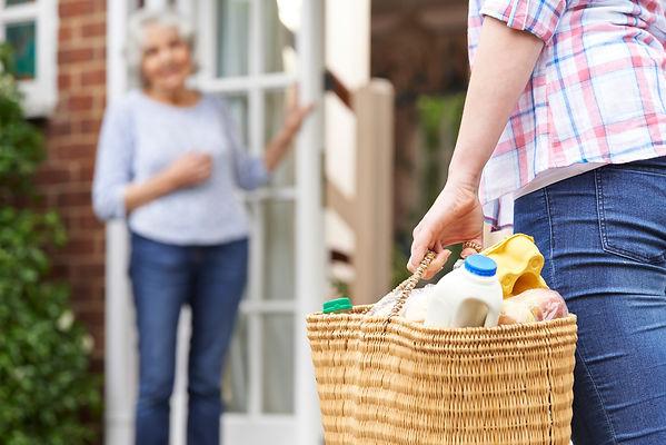 Person Doing Shopping For Elderly Neighb