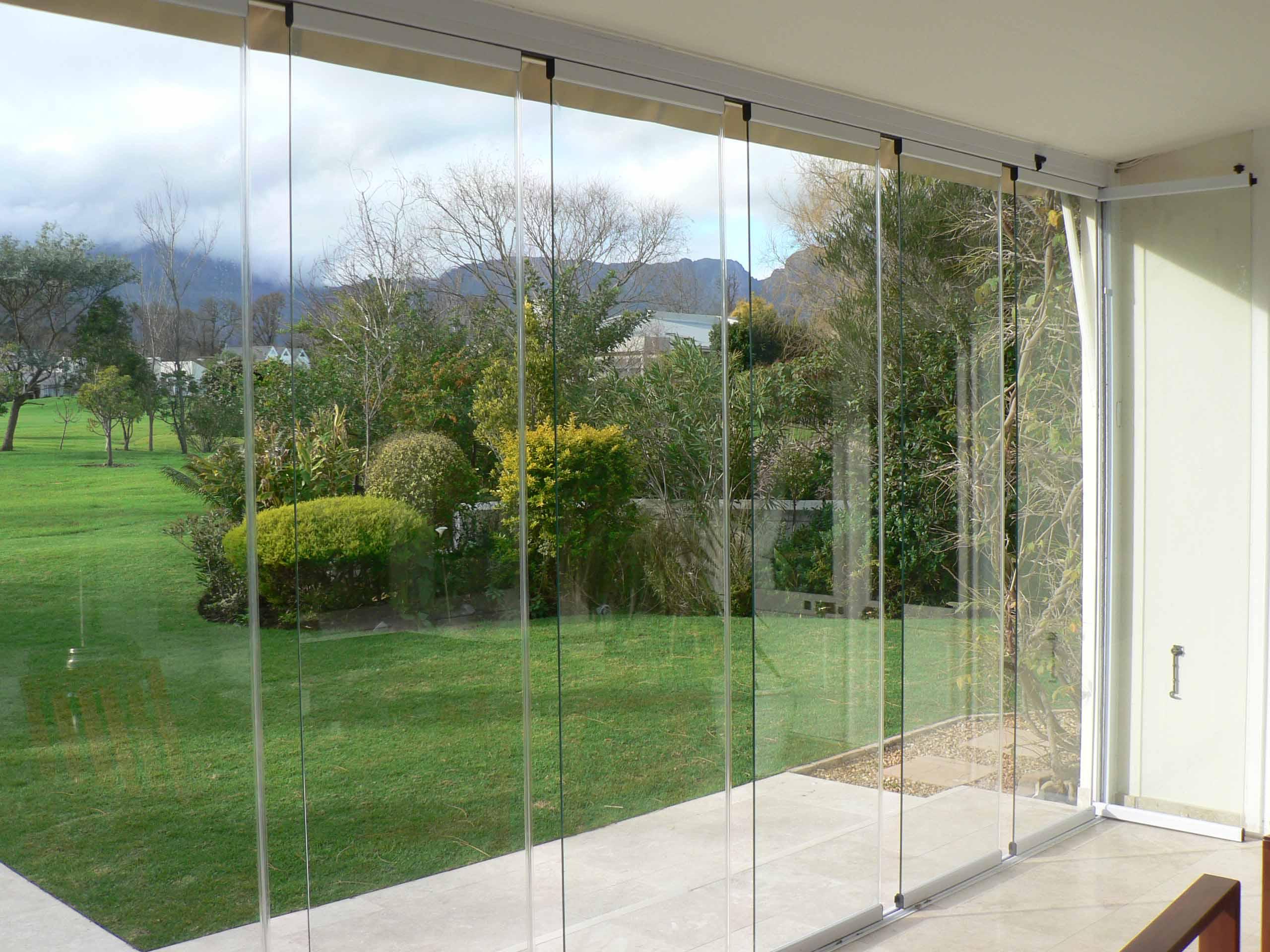Frameless exterior sliding glass doors womenofpowerfo glass door exterior frameless home design game hay planetlyrics Gallery