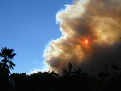 Sun behind a Firestorm cloud