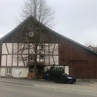 6-Zi.-Appartementhaus mit angebautem Schopf und Remise