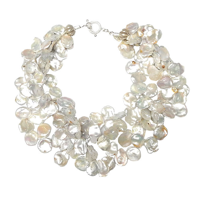 A Blast of White from a Multi Strand Necklace Collar of Large Keshi Pearls