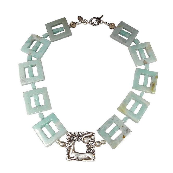 An Elegant Silver Deer Rests in a Necklace of Amazonite