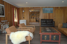 Luxury accommodation Hobart Tasmania spacious living room with Tasmanian  wood cladding