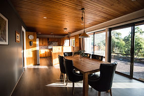 Dining room with Huon pine, luxury accommodation at Hobart Entrance