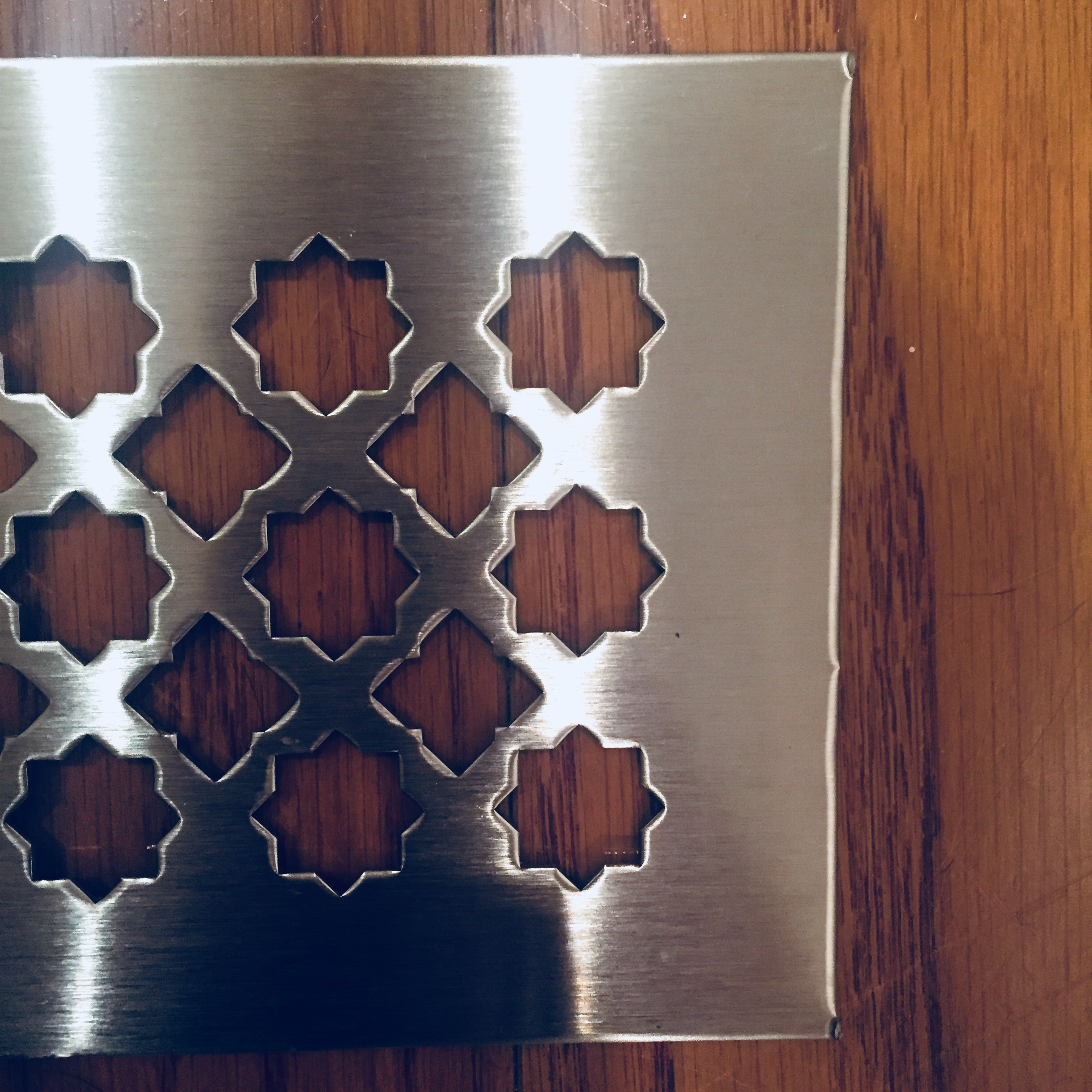 perforated grille in star pattern