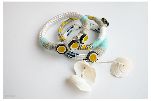 Yellow bracelets set with shells