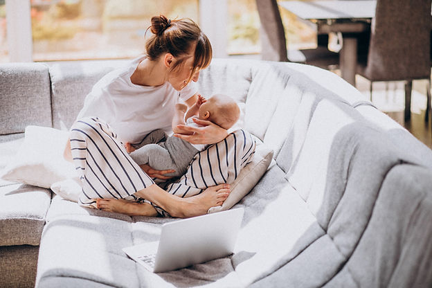 young-mother-with-her-kid-working-home-c