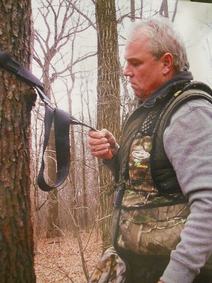 Deer hunter using Q-Safe Tree Strap to safely climb a tree as a hunter saftey system