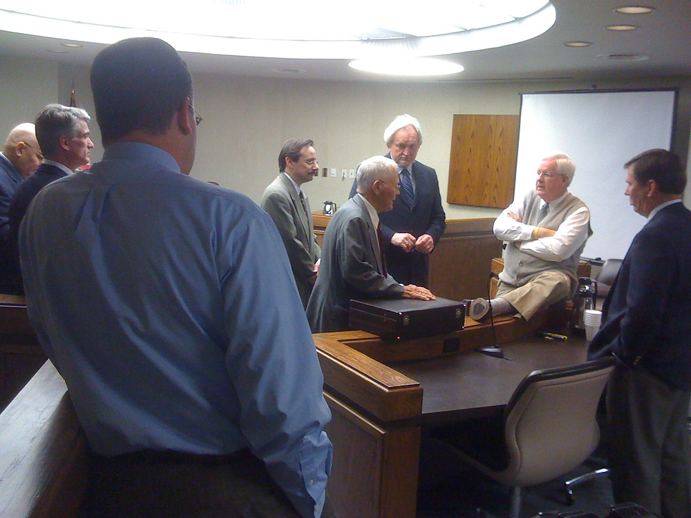 "Richard ""Racehorse"" Haynes speaks with Judge Steve Smith as P. David Romei and attorneys look on."