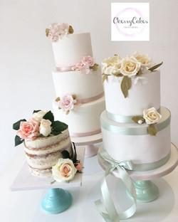 A trio of elegant Wedding Cakes being sh