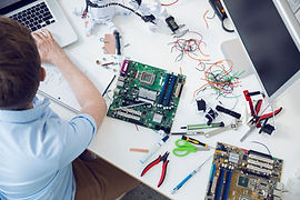 Electrical engineer working on circuit board