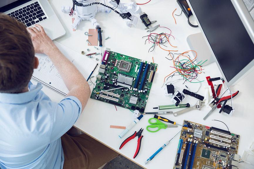 Electrical engineer working on circuit board