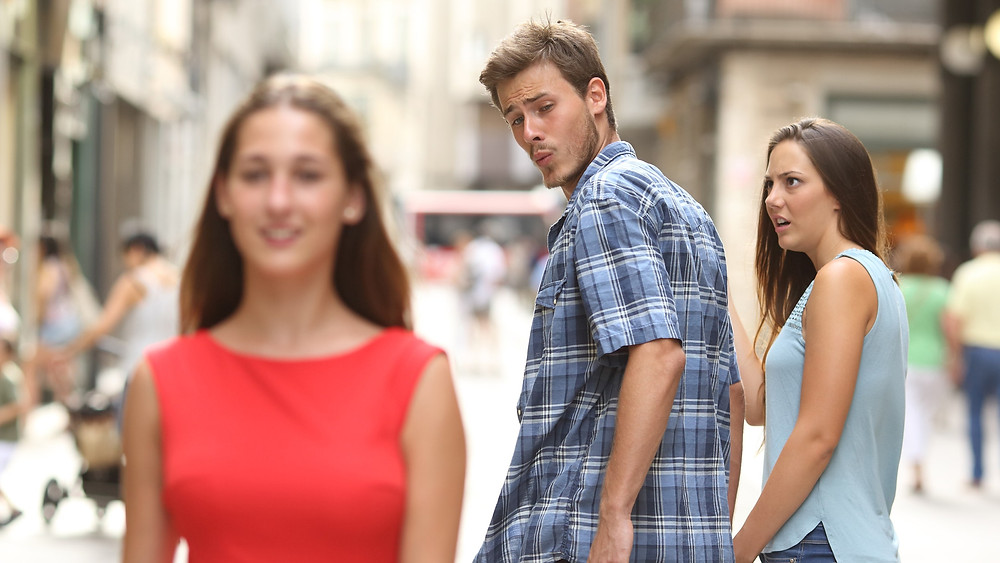 The Distracted Boyfriend meme, where a stock photo has become pop culture comedy.
