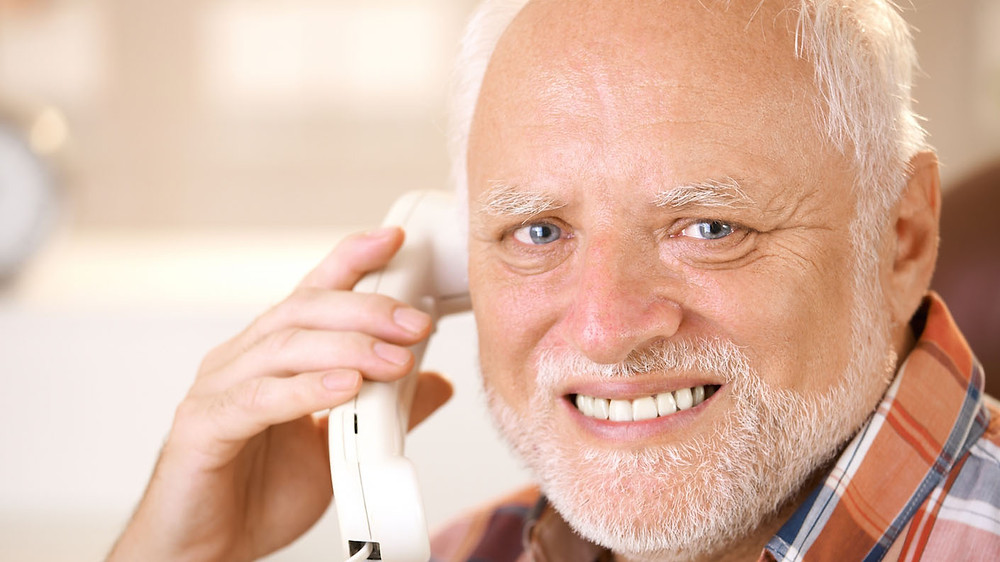 Hide the Pain Harold - a stock photo that went viral as the man looks uncomfortably into the camera