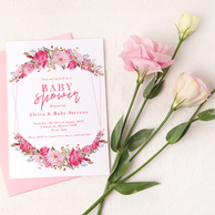 Floral baby shower invitation on a pink background with roses