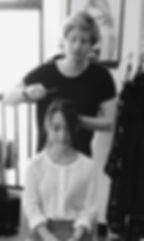 Clement styling one of his client's hair at emmanuelf salon