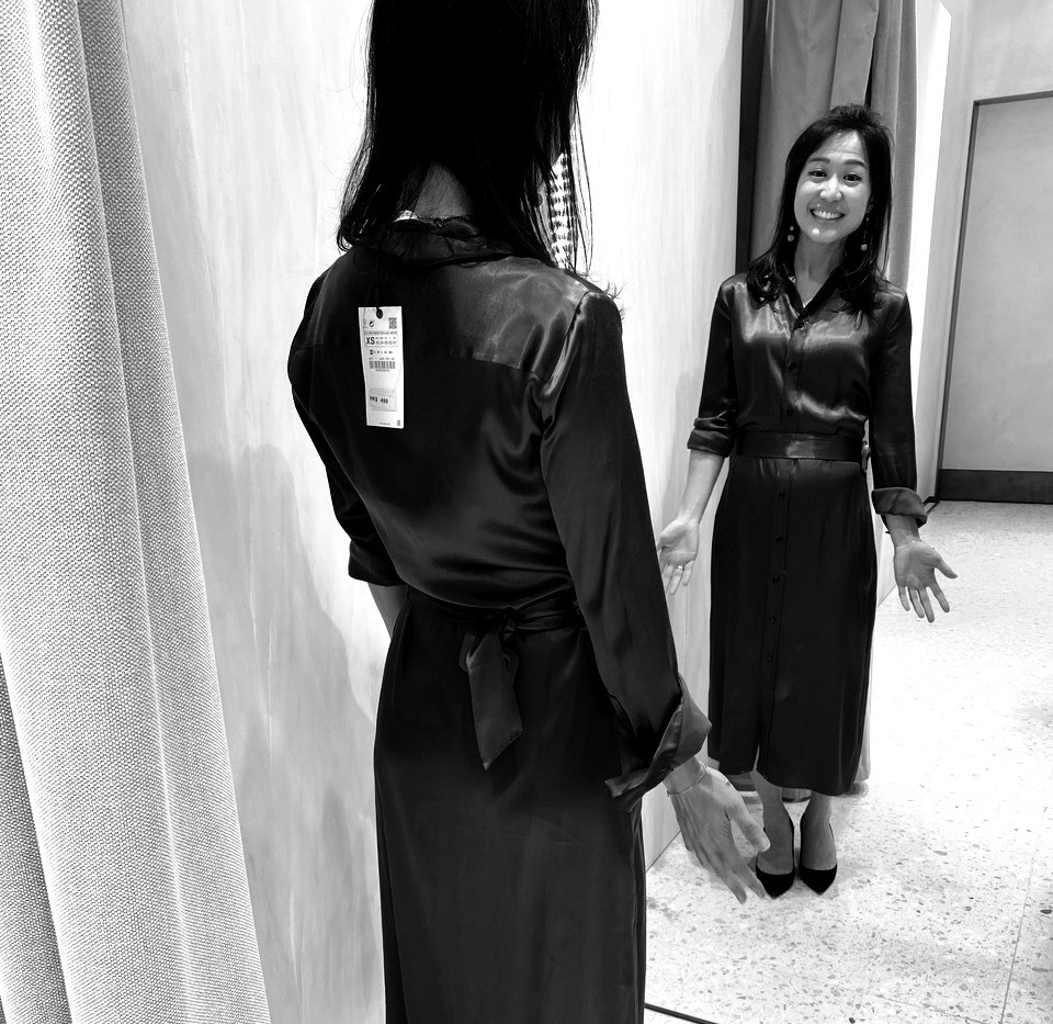 Celine analysing the fit of a flowy dress