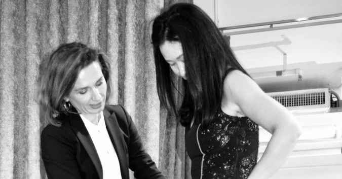 Celine Lamour helping client select the perfect elegant evening dress