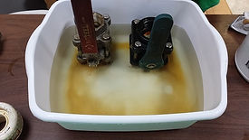 Dirty valves soaking in EcoGen parts washer cleaner