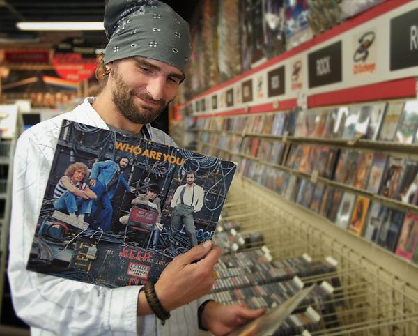 Man shopping for Vinyl at CD Exchange Muskegon.
