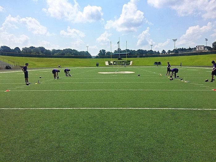 Trinity Kicking puts their athletes through kicking drills that teach technique.