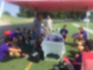 A Trinity Kicking Coach talks to players and allows football coaches to join their session.