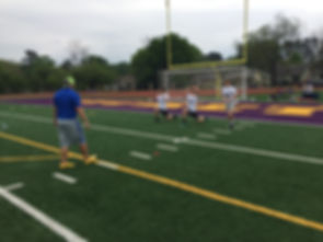 Kickers an punters stretch using the best methods possible for their bodies and positions.