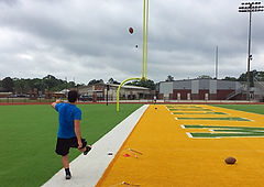 A Trinity Kicker works on accuracy drills by kickig at the uprigts.