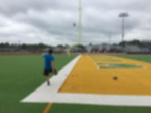 A Trinity Kicking athete performs the accuracy drill for kickers at a kicking camp