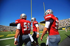 Trinity Kicking Kicker, Punter, and Longsnapper walk out of the tunnel at the Univerist of Oregon ready to play. Trinity Kickin produces the top division 1 kickers an punters.