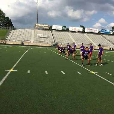 Trinity Kicking athletes go through a grueling warmup for kickers and punters.