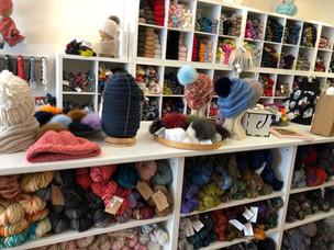 Knitted Hats, Fur Pompoms, Knitting Pattern Books, Knitted Cowl, Yarn Box, Yarn Project Bags, bulky yarn display, dk yarn display