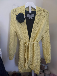 Lovely lightweight cardigan knit in bulky cotton yarn, worn with a cashmere flower brochet and handmade lace necklace