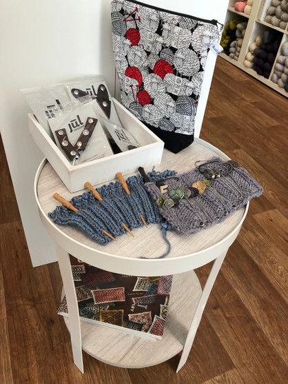 Wooden and metal shawl pin display, JUL leather closures, Alter Knit Stitch Dictionary book, and Katydid project bag