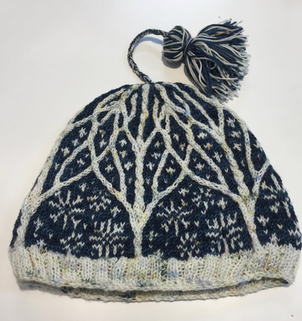 Knitted Korrland Hat in The Uncommon Thread and Little Bean Loves Yarn Fingering Weight Yarn