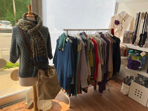 Knitted garments on clothing rack