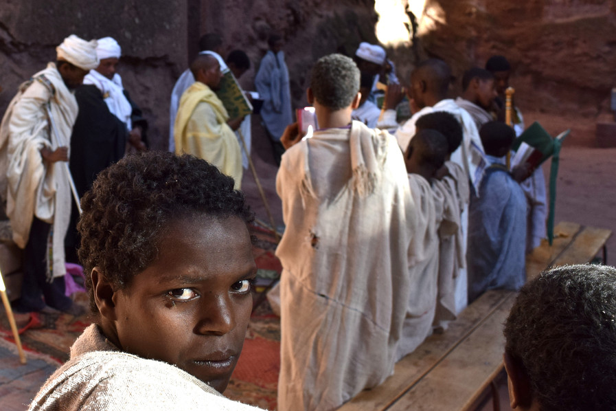 A young religious scholar pausing during the chanting at the holy site of Lalibela in Ethiopia, 2016.