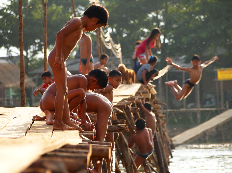 Kids jumping from a bridge in Vang Vieng, Laos, in 2011.