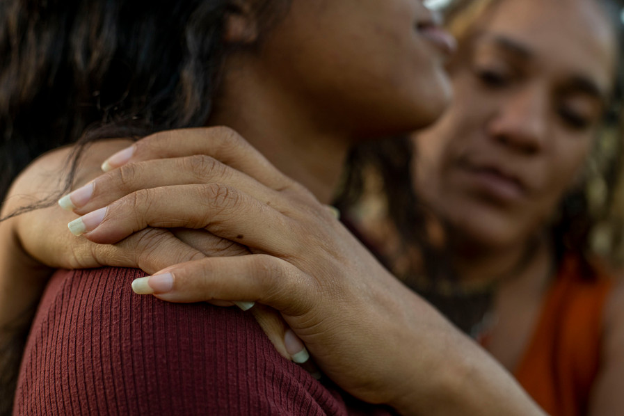 Ayisha Elliot holds her daughter Barbara outside of Churchill High School in Eugene, Or. Barbara spoke with Elizabeth Gabriel at KLCC about experiencing discrimination in school based on her race.