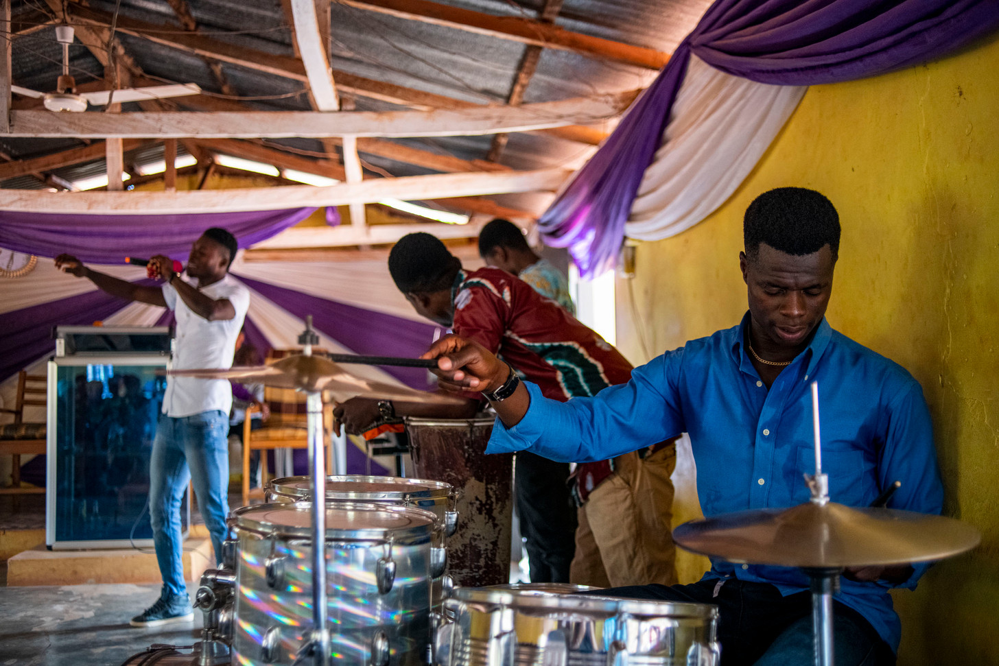 Cosmos Antwi Owusu plays the drums in church on Sundays in Boabeng, Ghana 2020