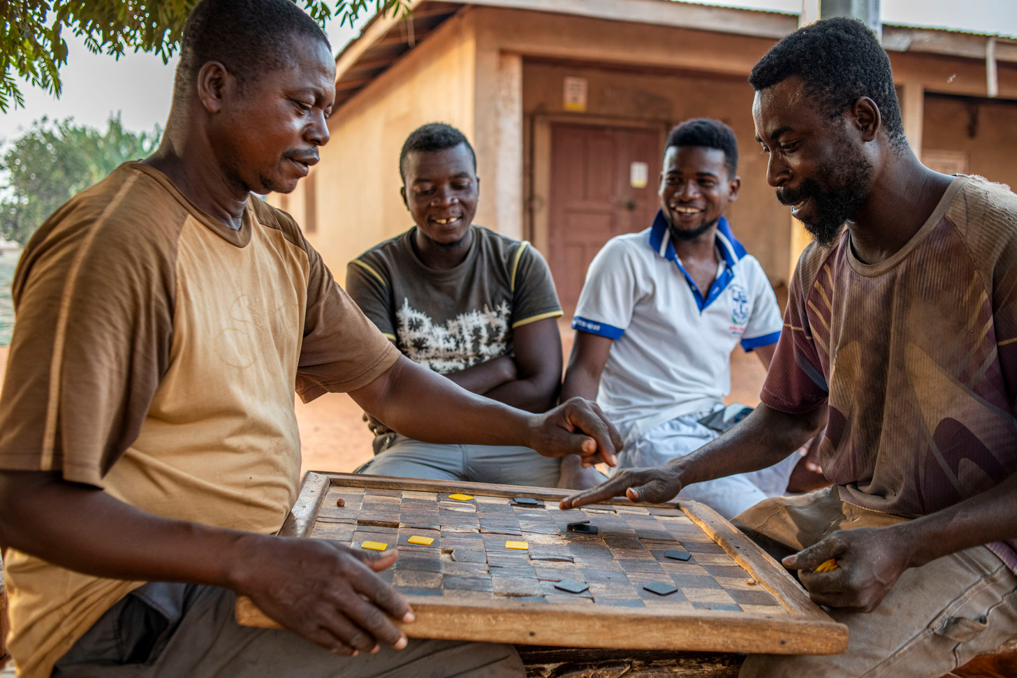Playing checkers in the evening in Fiema, Ghana 2020