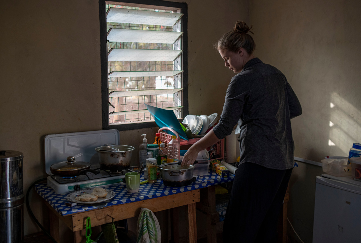 Biological anthropologist Diana Christie in her kitchen at the Boabeng Fiema Monkey Sanctuary Guesthouse where she lives for 6 months a year while conducting field research. Boabeng, Ghana 2020
