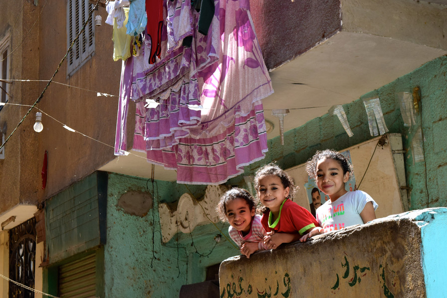 Sisters on a balcony in Cairo, Egypt, 2017.