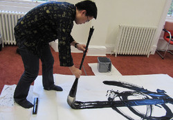 chi-zhang-with-mop-size-brush-.jpg