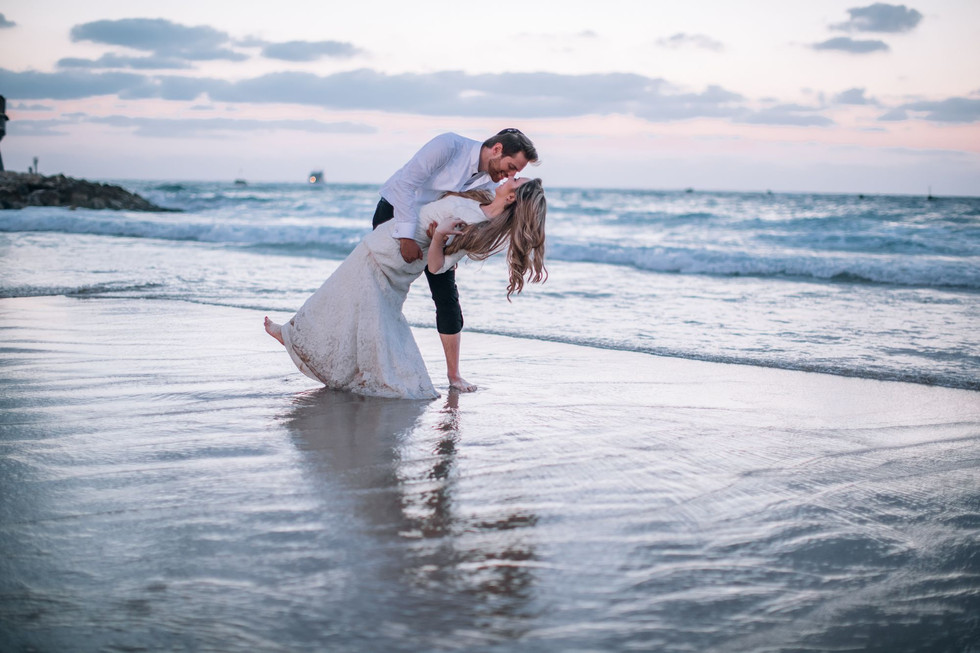 Bride & Groom Frolic on Israeli Beach