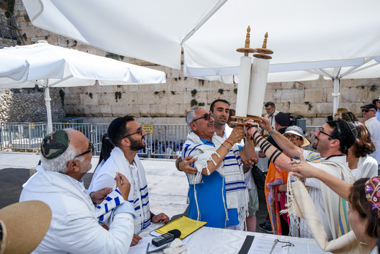Bat Mitzvah girl's uncle is given the honor of holding the Torah scrolls