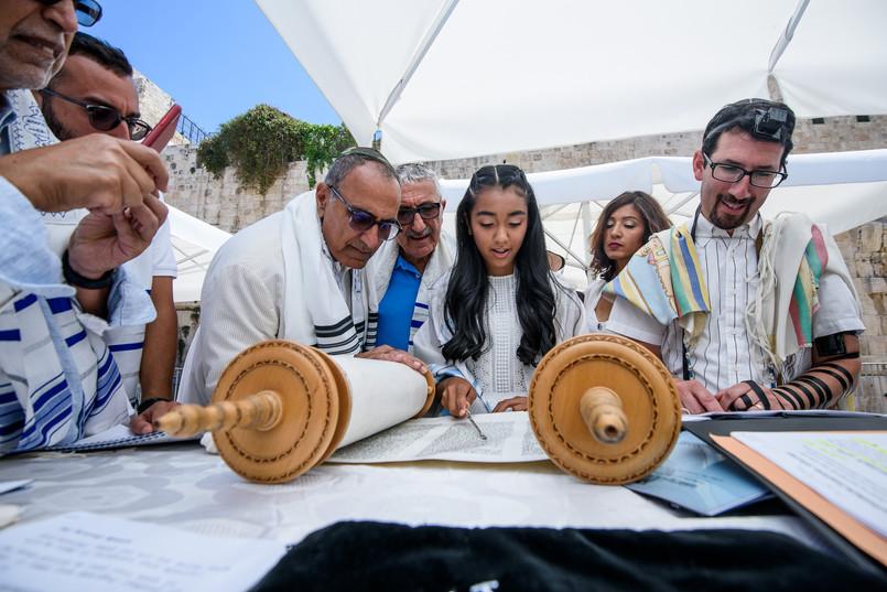 Bat Mitzvah girl reads from the Torah in Jerusalem